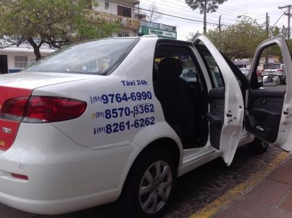 Táxi Evilásio e Emerson 24 horas ponto taxi hospital Torres RS Foto 5